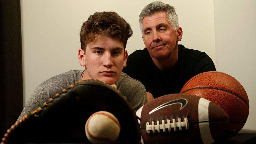 Aidan Cullen -- shown with his father, Mark -- was a three-sport athlete as a child but has since been diagnosed with a neurological disorder called Central Pain Syndrome. He still plays baseball at Windward.