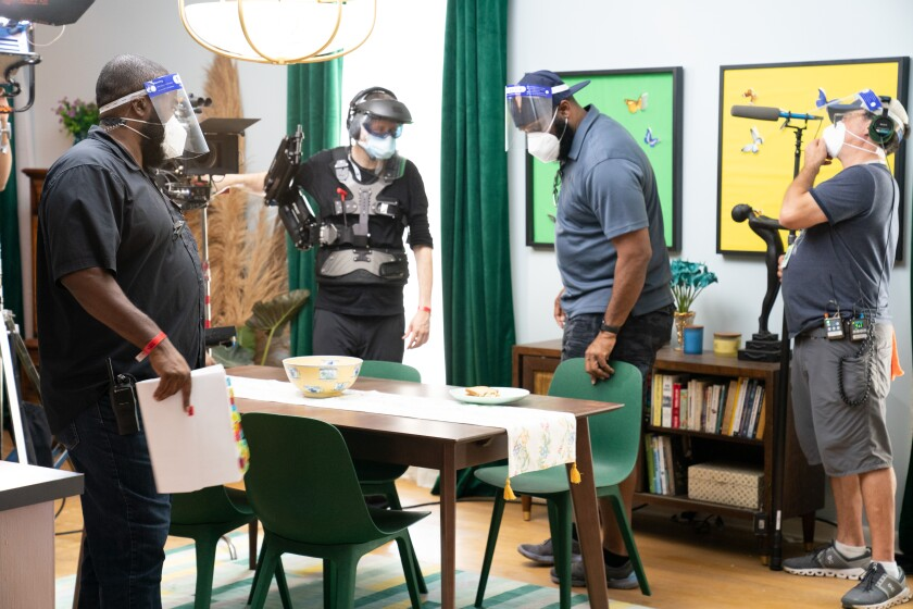 """A film crew shoots on the set of Tyler Perry's show """"Sistas"""" using COVID-19 safety protocols."""