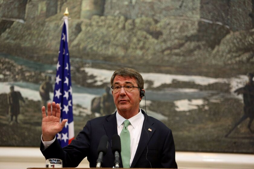 U.S. Secretary of Defense Ash Carter, speaks during a press conference with Afghan President Ashraf Ghani, at the Presidential Palace in Kabul, Afghanistan, Tuesday, July 12, 2016. (AP Photo/Rahmat Gul)