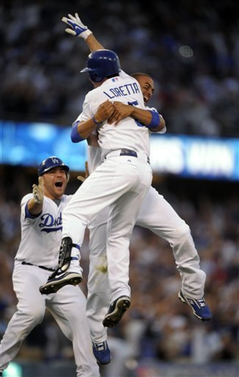 Los Angeles Dodgers' Matt Kemp, right, celebrates Mark Loretta's base hit to win the game along with Russell Martin, left, during the ninth inning of Game 2 of the National League division baseball series against the St. Louis Cardinals, Thursday, Oct. 8, 2009, in Los Angeles. The Dodgers won 3-2. (AP Photo/Mark J. Terrill)