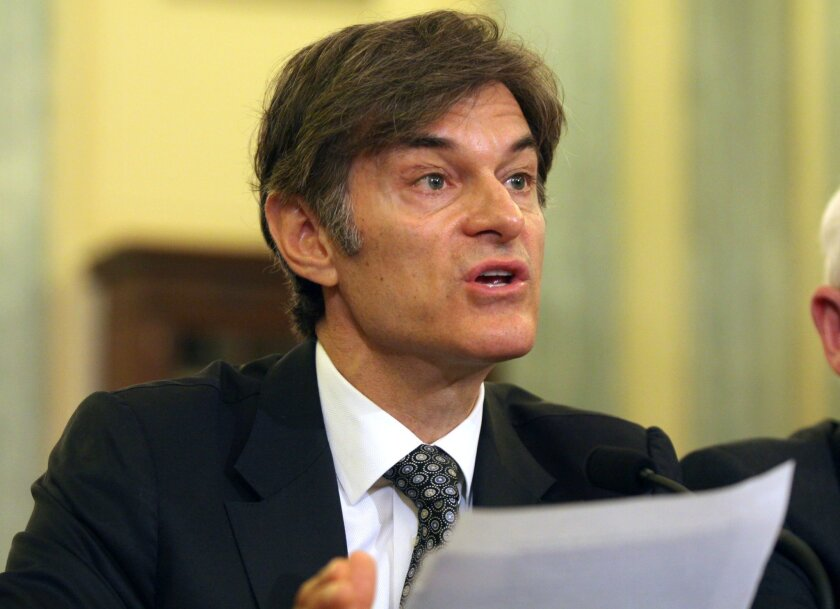 Dr. Mehmet Oz, vice chairman and professor of surgery, Columbia University College of Physicians and Surgeons, testifies on Capitol Hill in Washington. Ten top physicians want Columbia University to remove the celebrity doctor from his medical faculty position.