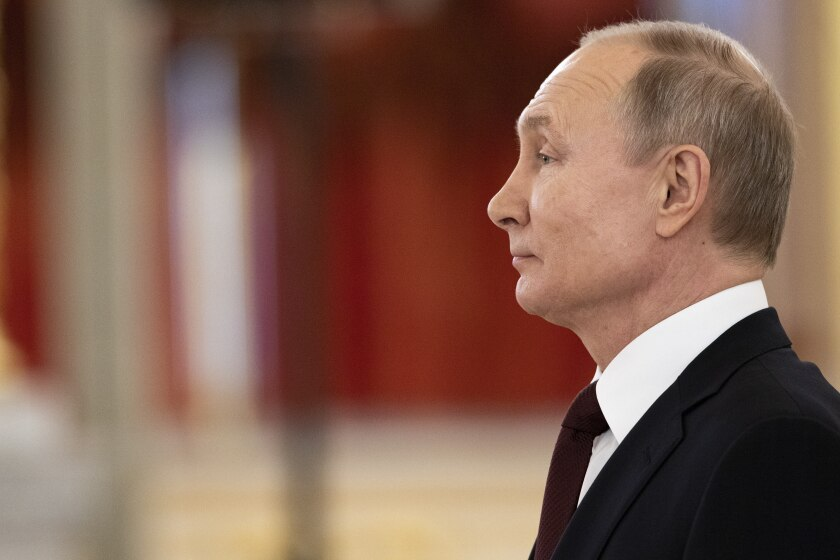 Russian President Vladimir Putin attends a ceremony to receive credentials from newly appointed foreign ambassadors to Russia in Kremlin, in Moscow, Russia, Wednesday, Feb. 5, 2020. (AP Photo/Alexander Zemlianichenko, Pool)