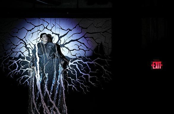 """Jason Adams, as Tom, during Overtone Industries' """"Songs and Dances of Imaginary Lands,"""" which is performed inside a former car dealership in Culver City."""