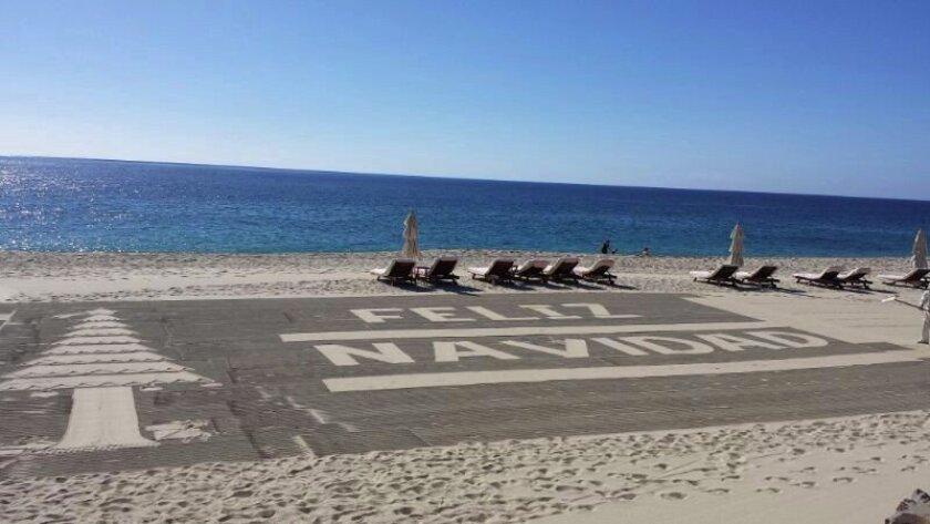 Merry Christmas greeting is written on the beach at Las Ventanas al Para in Los Cabos, Baja California.