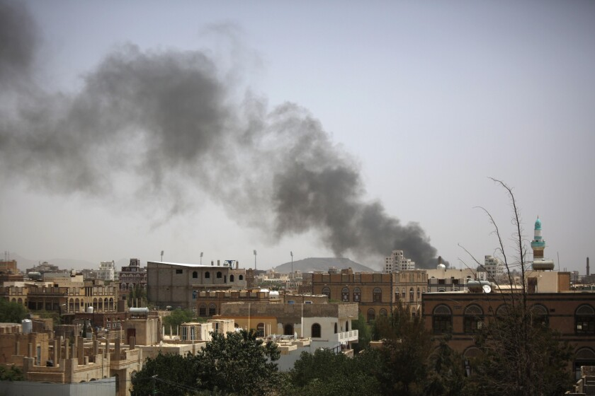 Smoke rises after an airstrike in Yemen's capital, Sana, on July 10. Loud explosions were heard in the city before a U.N.-brokered cease-fire took effect at midnight.