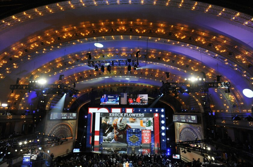 New York Giants selects Miami offensive lineman Ereck Flowers as the ninth pick in the first round of the 2015 NFL Football Draft,  Thursday, April 30, 2015, in Chicago. (AP Photo/Paul Beaty)