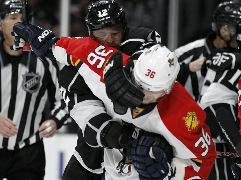 Los Angeles Kings right wing Marian Gaborik (12), of Slovakia, struggles against Florida Panthers left wing Jussi Jokinen (36), of Finland during the second period of an NHL hockey game in Los Angeles, Saturday, Nov. 7, 2015. (AP Photo/Alex Gallardo)