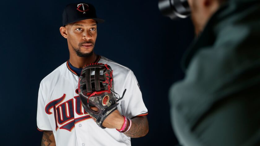 The Twins' Byron Buxton poses for a photographer on the team's media day during spring training baseball, Wednesday, Feb. 21, 2018, in Fort Myers, Fla.
