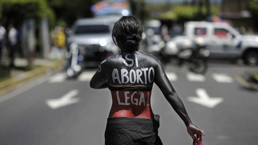 A woman marches in support of the decriminalization of abortion, on September 28, 2012 in San Salvador.