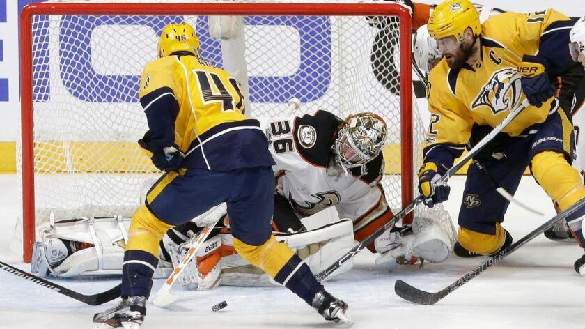 Anaheim Ducks goalie John Gibson (36) blocks a shot as Nashville Predators left wing Pontus Aberg (4