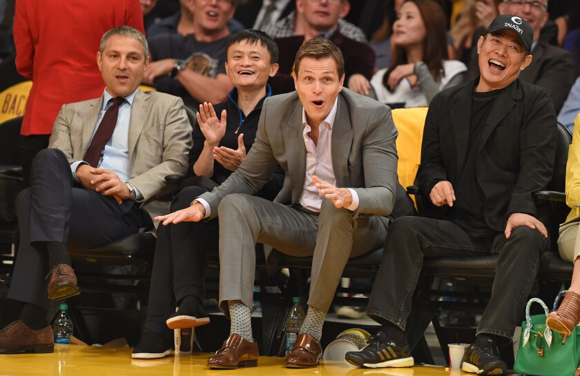 Endeavor Chief Executive Ari Emanuel, left, Alibaba founder Jack Ma, Endeavor Executive Chairman Patrick Whitesell and actor Jet Li attend a Lakers game against the Houston Rockets at Staples Center in 2014. Endeavor's future has been the subject of intense speculation in Hollywood.