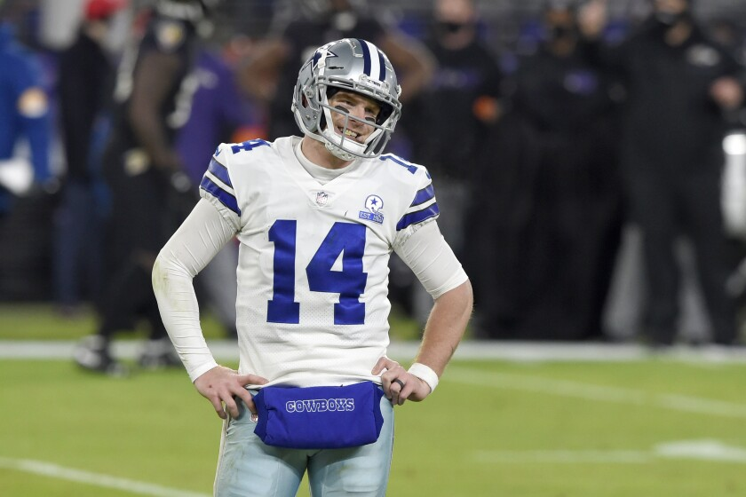 Dallas Cowboys quarterback Andy Dalton reacts after a play against the Baltimore Ravens during the second half of an NFL football game, Tuesday, Dec. 8, 2020, in Baltimore. (AP Photo/Gail Burton)