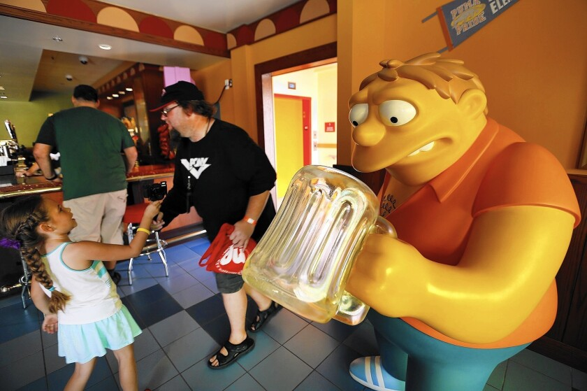 """The new Springfield at Universal Studios Hollywood boasts nine places to eat, including Moe's Tavern. The city block-sized neighborhood features a collection of landmarks inspired by """"The Simpsons."""""""