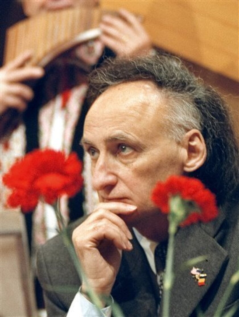 Moldovan poet Grigore Vieru, admired for his courage in promoting Romanian, the country's native language, when Moldova was a Soviet republic looks on during a traditional music event in Chisinau, Moldova, on Feb. 15, 2005. Vieru died Sunday in a hospital in Chisinau, Moldova's capital city, after
