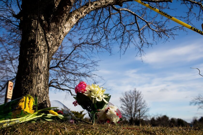 Flowers lie near a makeshift memorial outside a Cracker Barrel restaurant in Kalamazoo, Mich. According to police, a man drove around Kalamazoo fatally shooting several people at multiple locations on Saturday, including the parking lot of the restaurant. Authorities identified the shooter as Jason Dalton.