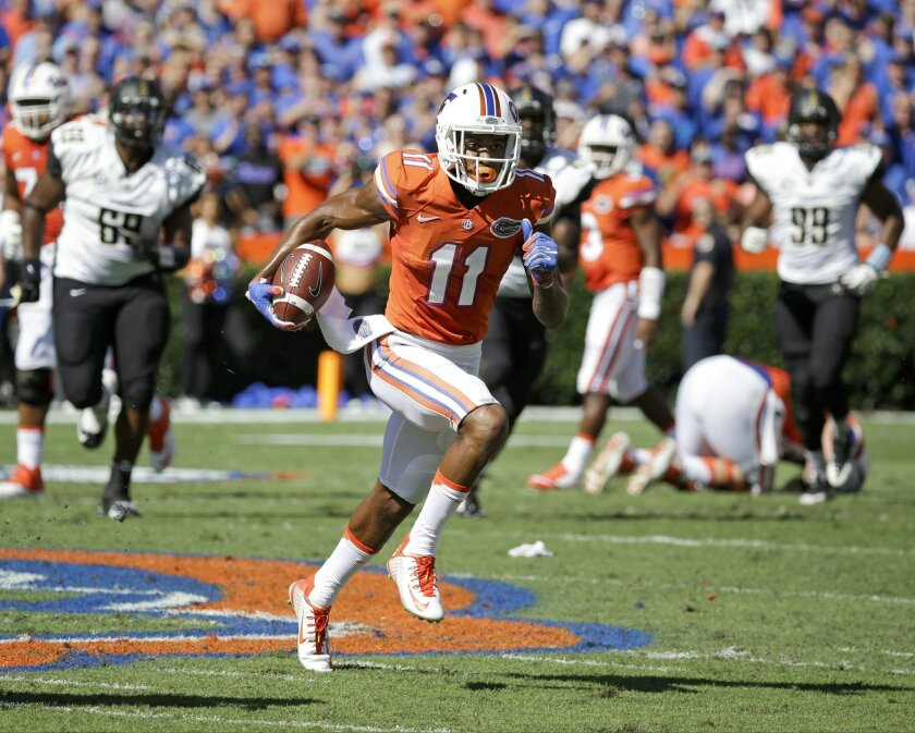 Florida wide receiver Demarcus Robinson (11) runs for yardage against Vanderbilt after a reception during the first half of an NCAA college football game, Saturday, Nov. 7, 2015, in Gainesville, Fla. (AP Photo/John Raoux)