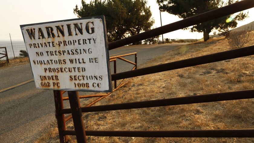 GAVIOTA, CA - JULY 29, 2016 - Signs warn of possible trespassing on Hollister Ranch Road at the entr