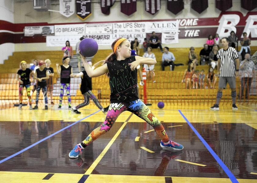 Claire Turner with the Dodging Maniacs takes a shot during SchoolPower's annual Dodgeball Tournament for Laguna Beach Unified schools Wednesday.