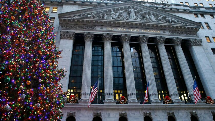 Christmas decorations adorn the facade of the New York Stock Exchange.