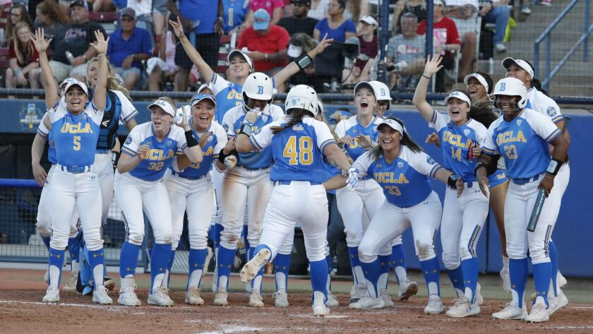 UCLA celebrates as Bubba Nickles (48) comes home after a home run against Oklahoma in the sixth inni