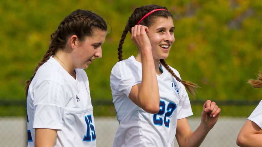 Ashlin Healy (left) and Erin Healy (right), shown in an earlier game, accounted for all three goals in OLP's regional championship triumph.
