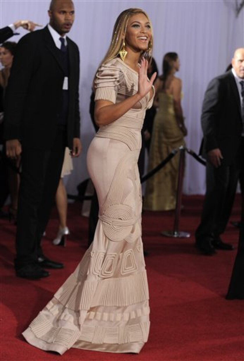 Beyonce arrives at the Grammy Awards on Sunday, Jan. 31, 2010, in Los Angeles. (AP Photo/Chris Pizzello)