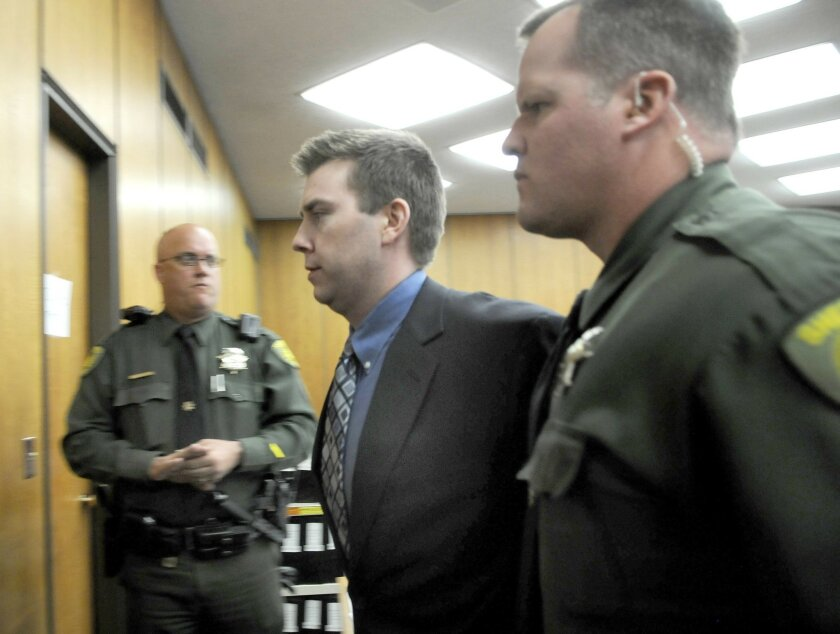 FILE - In this June 2, 2010 file photo, James Biela is led from the courtroom in Reno, Nev. A jury sentenced Biela to death for raping and killing a college coed after sexually assaulting two others in a string of attacks that had the city of Reno on edge for most of 2008. A lawyer for Biela goes before a Washoe County judge next week in the latest attempt to overturn his convictions. (AP Photo/Marilyn Newton, Pool, File)