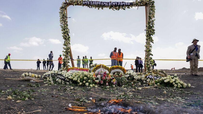 A flower-adorned memorial arch erected at the site of the Ethiopian Airlines crash on March 14 in Ejere, Ethiopia.