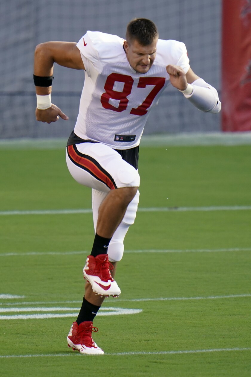 Tampa Bay Buccaneers tight end Rob Gronkowski (87) stretches his legs as he runs during an NFL football training camp practice Friday, Aug. 28, 2020, in Tampa, Fla. (AP Photo/Chris O'Meara)