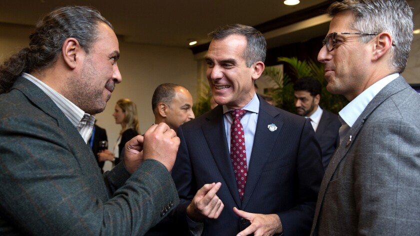 Mayor Eric Garcetti, center, and Casey Wasserman, right, chat with ANOC President Sheikh Ahmad Al-Fahad Al-Sabah during a reception Tuesday in Washington.