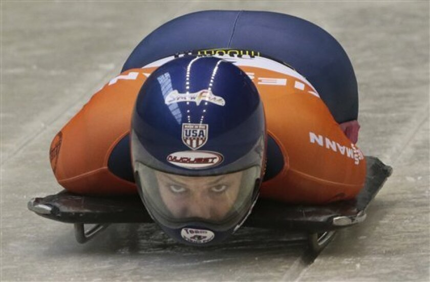 Winner Noelle Pikus-Pace of the U.S.A. looks on during the women's Bob event at the FIBT Bob & Skeleton World Cup 2013, in Krasnaya Polyana resort, east of Sochi, Russia, Saturday, Feb. 16, 2013. (AP Photo/Mikhail Metzel)