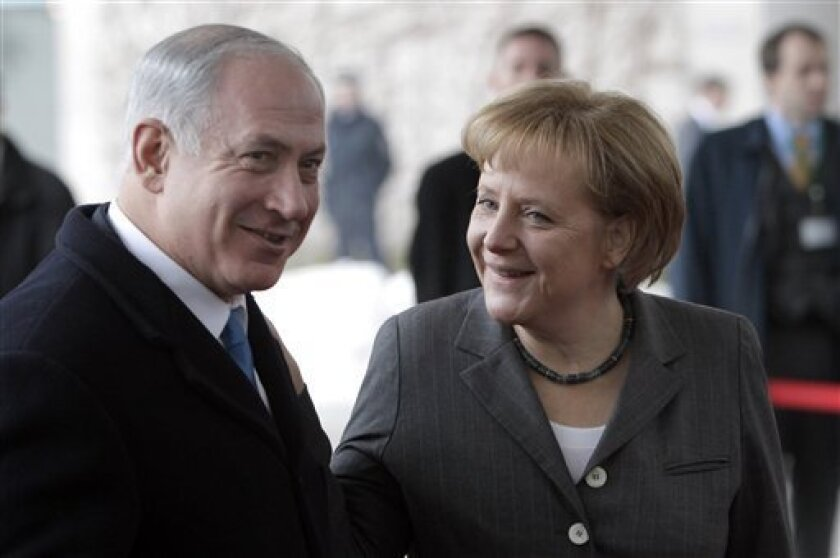German Chancellor Angela Merkel, right, welcomes Israeli Prime Minister Benjamin Netanyahu, left, for a meeting at the chancellery in Berlin, Germany, Monday, Jan. 18, 2010. Benjamin Netanyahu and his cabinet are in Berlin for a special joint session of the German and Israeli governments. (AP Photo