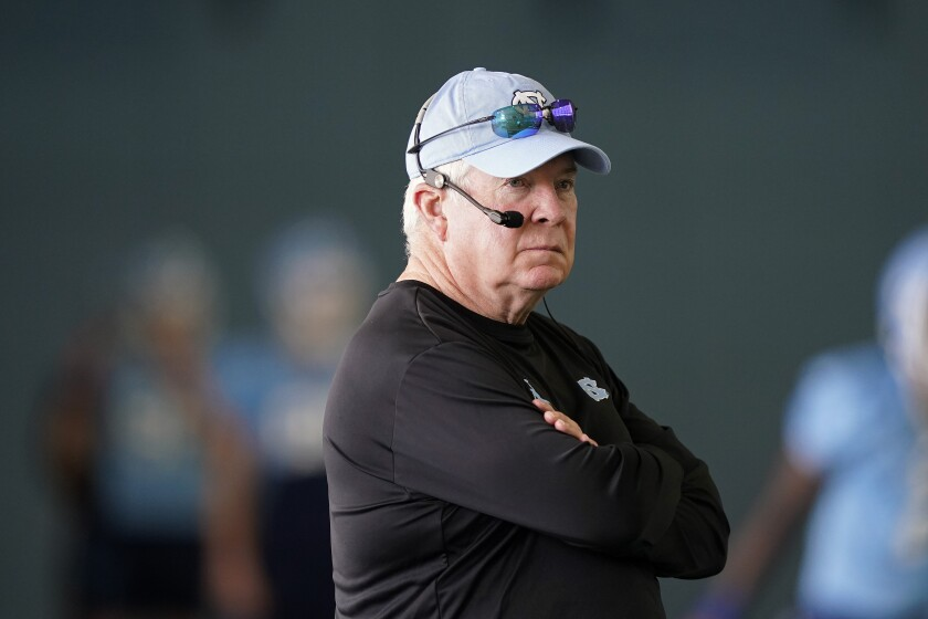 FILE - North Carolina coach Mack Brown watches during an NCAA college football practice in Chapel Hill, N.C., in this Thursday, Aug. 5, 2021, file photo. The Tar Heels return 18 starters from an eight-win team and are picked to win the ACC's Coastal Division. (AP Photo/Gerry Broome, File)