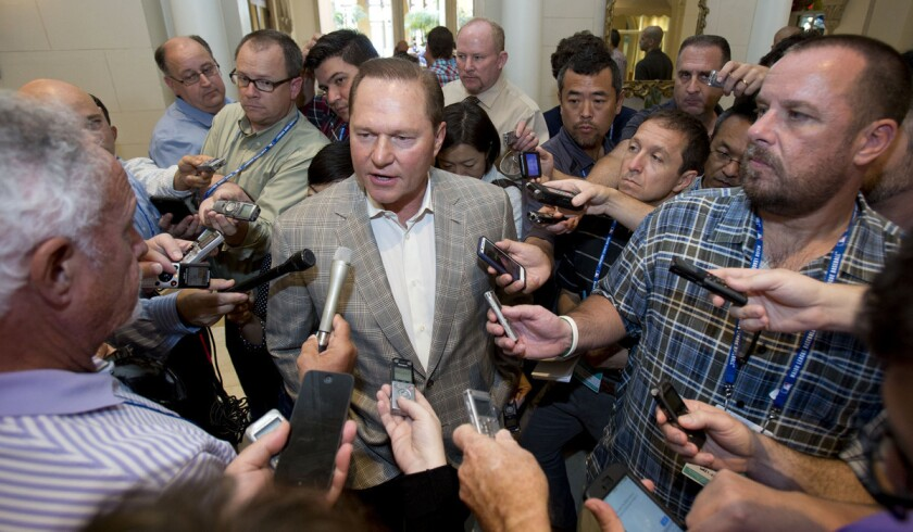 Sports agent Scott Boras speaks to reporters at the baseball general managers meetings on Nov. 11 in Boca Raton, Fla.