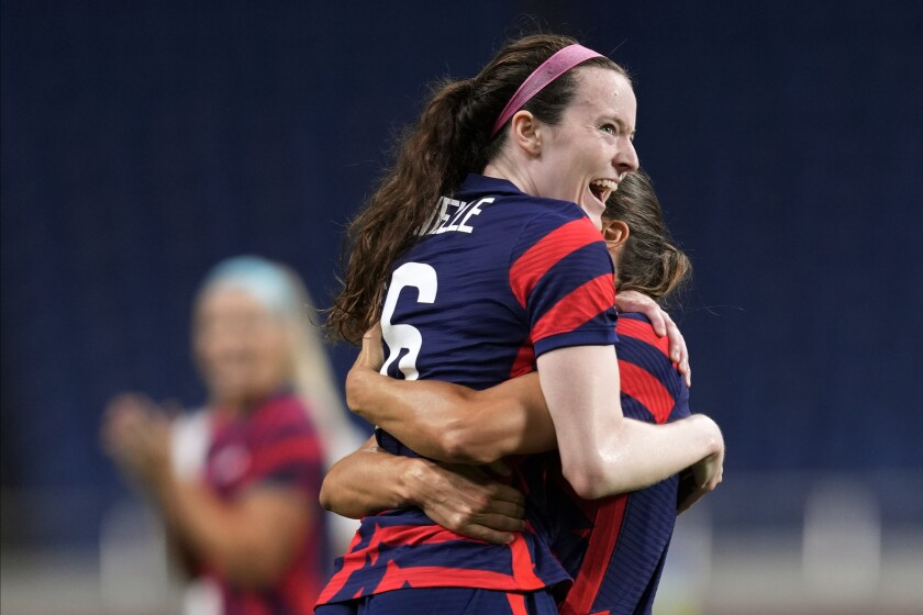 Rose Lavelle, left, celebrates with a teammate after scoring a goal for the U.S. during a 6-1 victory over New Zealand.
