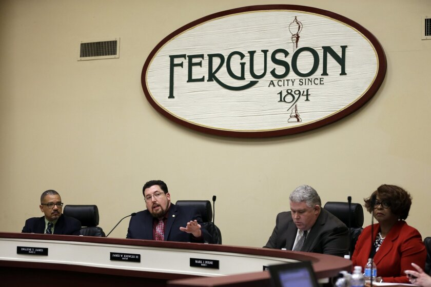 In this Feb. 2, 2016 file photo, Ferguson mayor James Knowles III, second from left, speaks during a city council meeting in Ferguson, Mo. Ferguson city leaders warned U.S. Department of Justice negotiators last month that approval of a settlement agreement was no sure thing, Knowles said Friday, F
