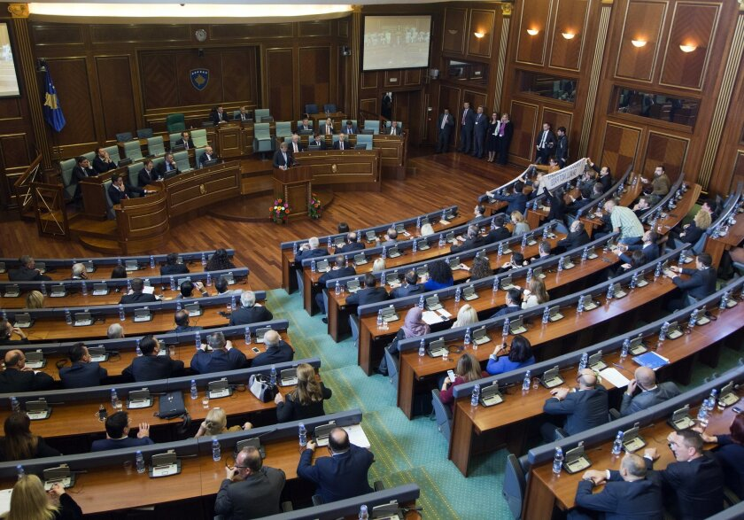 EU Commissioner for European Neighbourhood Policy & Enlargement Negotiations Johannes Hahn addresses lawmakers in Kosovo parliament in capital Pristina on Friday, Nov. 6, 2015. Hahn has warned Kosovo opposition members that blocking Parliament will hamper the country's further integration into the