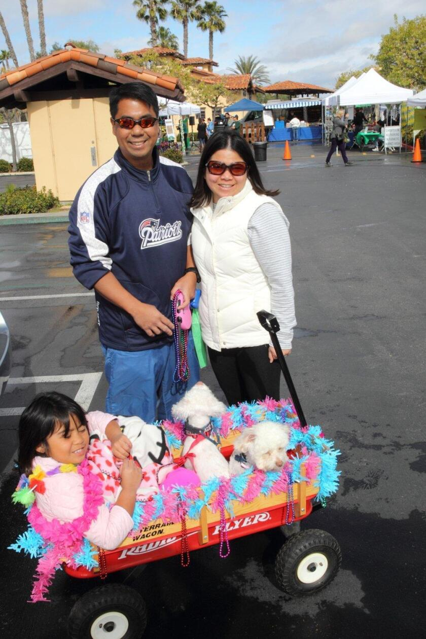 The Aban family with Charlie and Snowy