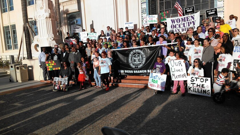 The marchers gathered for a photo on the steps of the County Administration Center on Pacific Highway. / Susan Shroder