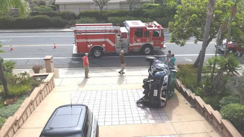 A car is flipped onto its side following an Aug. 3 accident on Cardeno Drive.
