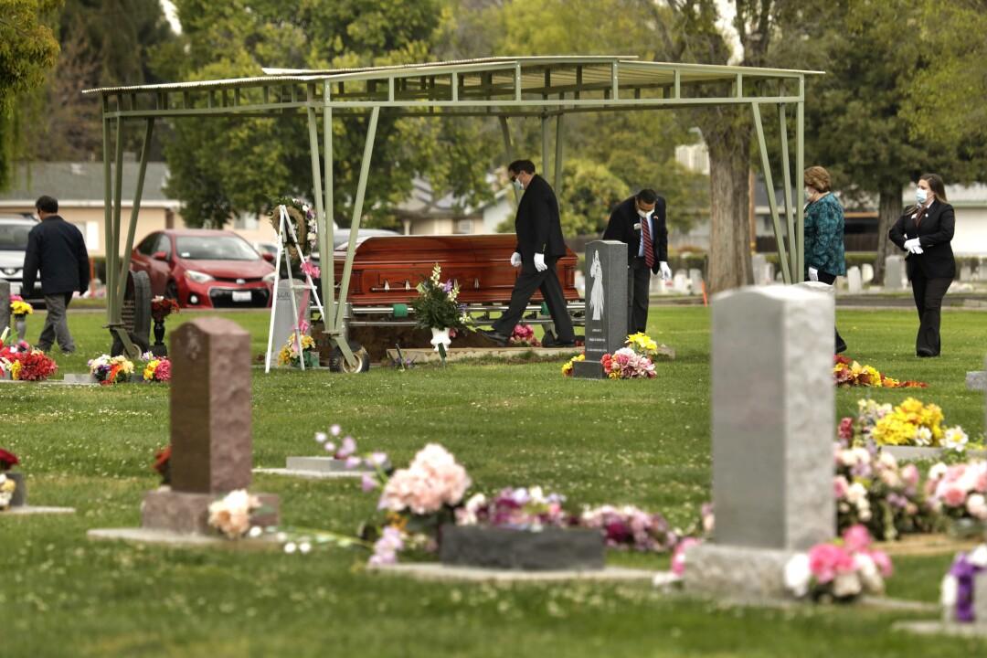Wanda DeSelle's casket is brought to her gravesite.