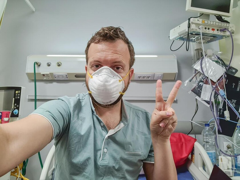 In this photo provided by Matt Swider, posted on Twitter on March 9, 2020, American tourist Matt Swider, takes a selfie while in quarantine in the north coast city of Marsa Matrouh, Egypt. When Swider was tested for the new coronavirus on his Nile cruise in Egypt's tourist hub of Luxor, he assumed the government was just taking extreme precautions. The healthy 35-year-old tech editor living in New York, couldn't have imagined that he would be confined indefinitely to a remote hospital on the country's north coast. For most people, the new coronavirus causes only mild or moderate symptoms. For some it can cause more severe illness. (Matt Swider via AP)