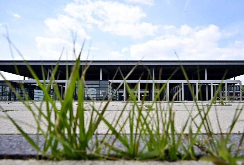 Grass grows at the main building of Berlin's new international airport, set to open in 2020 after years of delay.