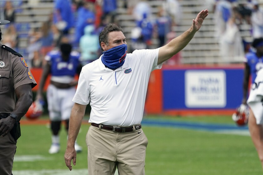 Florida head coach Dan Mullen waves to fans as he leaves the field after defeating Kentucky in an NCAA college football game, Saturday, Nov. 28, 2020, in Gainesville, Fla. (AP Photo/John Raoux)