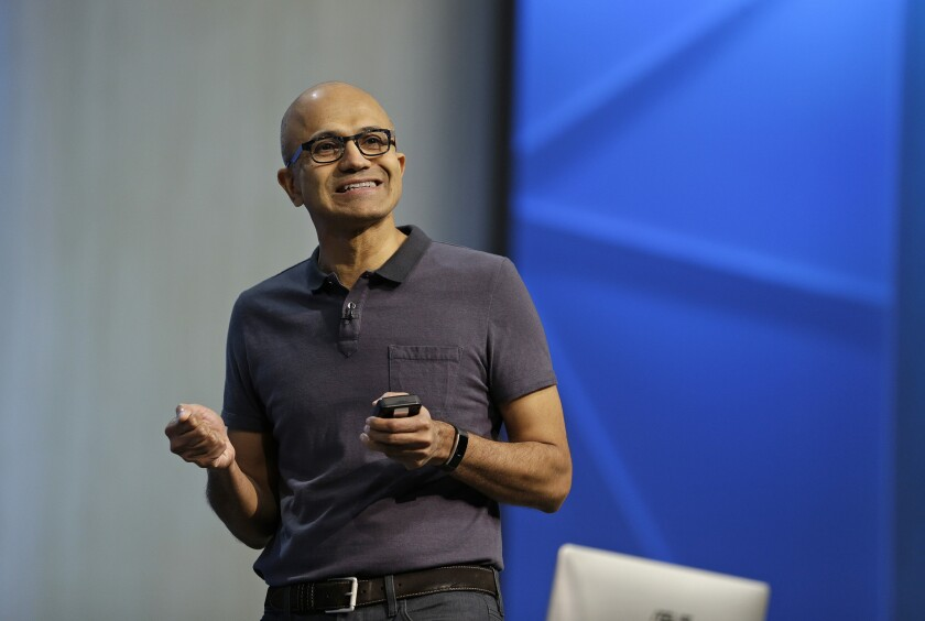 """Microsoft CEO Satya Nadella, pictured here giving a keynote speech at the 2016 Microsoft Build Conference, announced an expansion on Monday of a """"machine teaching"""" program to about 200 companies."""