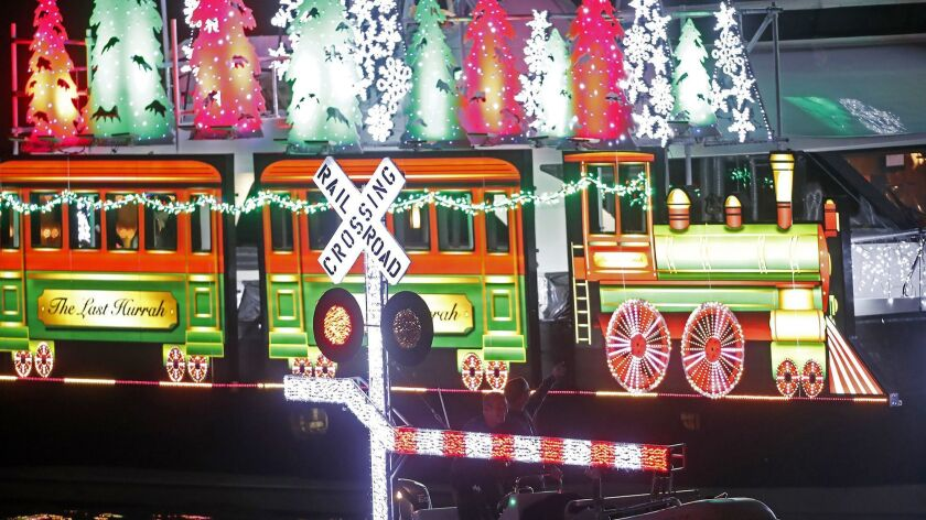 A boat decorated as a train cruises along during opening night of the 109th Newport Beach Christmas