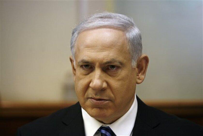 Israel's Prime Minister Benjamin Netanyahu attends the weekly cabinet meeting in Jerusalem Sunday, Dec. 6, 2009. (AP Photo/Baz Ratner, Pool)