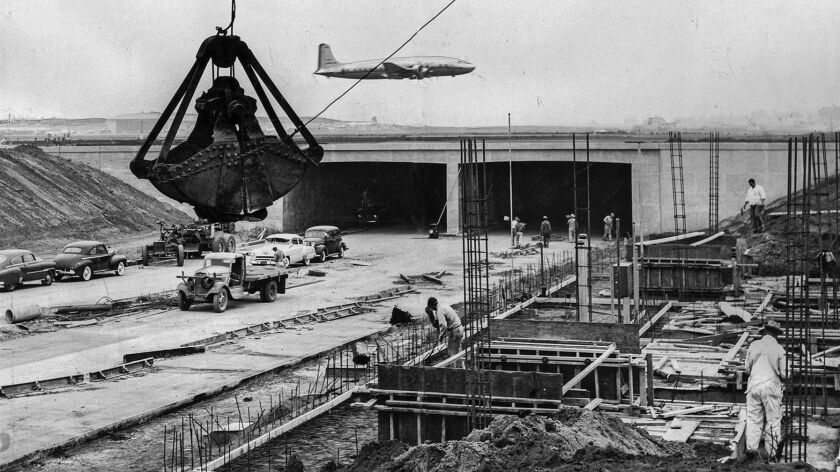 Oct. 15, 1952: Airliner takes off at Los Angeles International Airport as work goes on at the north