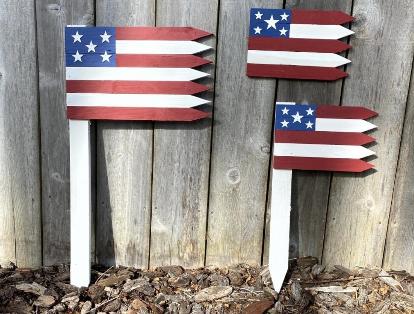 Some of the proceeds from wooden flags like these made by three Point Loma brothers benefit the Wounded Warrior Project.