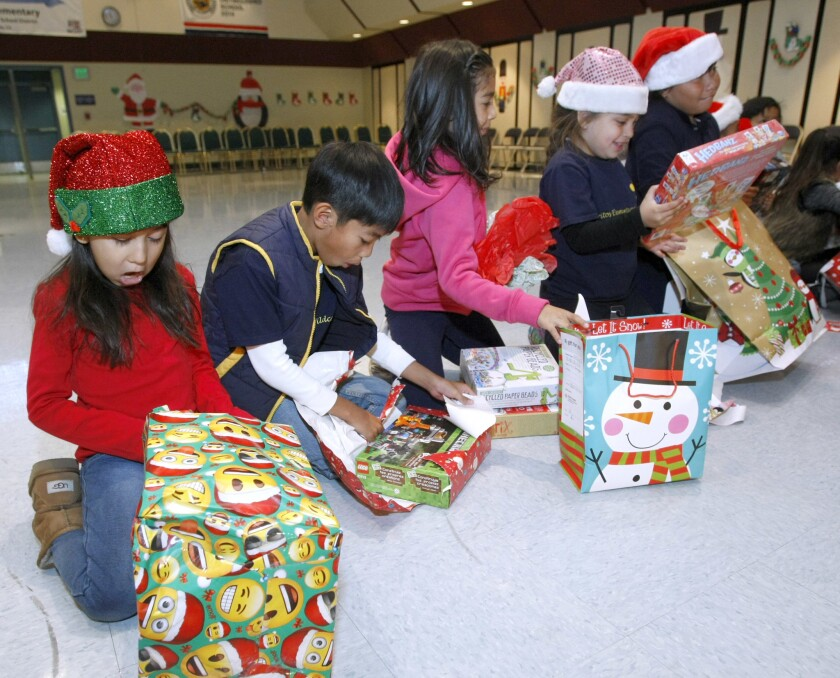 Cerritos Elementary students open their gifts